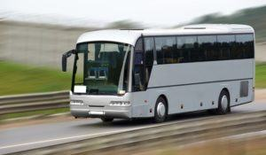 Fast moving tourist bus. Clipping path inside.
